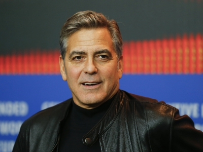 Speaking at the Berlin Film Festival, George Clooney revealed he is to meet the German Chancellor, Angela Merkel, to see how the film industry can help convey important messages. (Feb. 11)