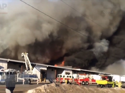 A massive warehouse fire in central New Jersey burning out of control for more than half a day has generated enough smoke to be detected by weather radar and forced some school closures. (Feb. 12)