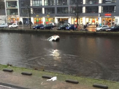 Video obtained by the Associated Press showed the dramatic rescue of a mother and her toddler after their car plunged into an Amsterdam canal. Video is silent. (Feb. 12)