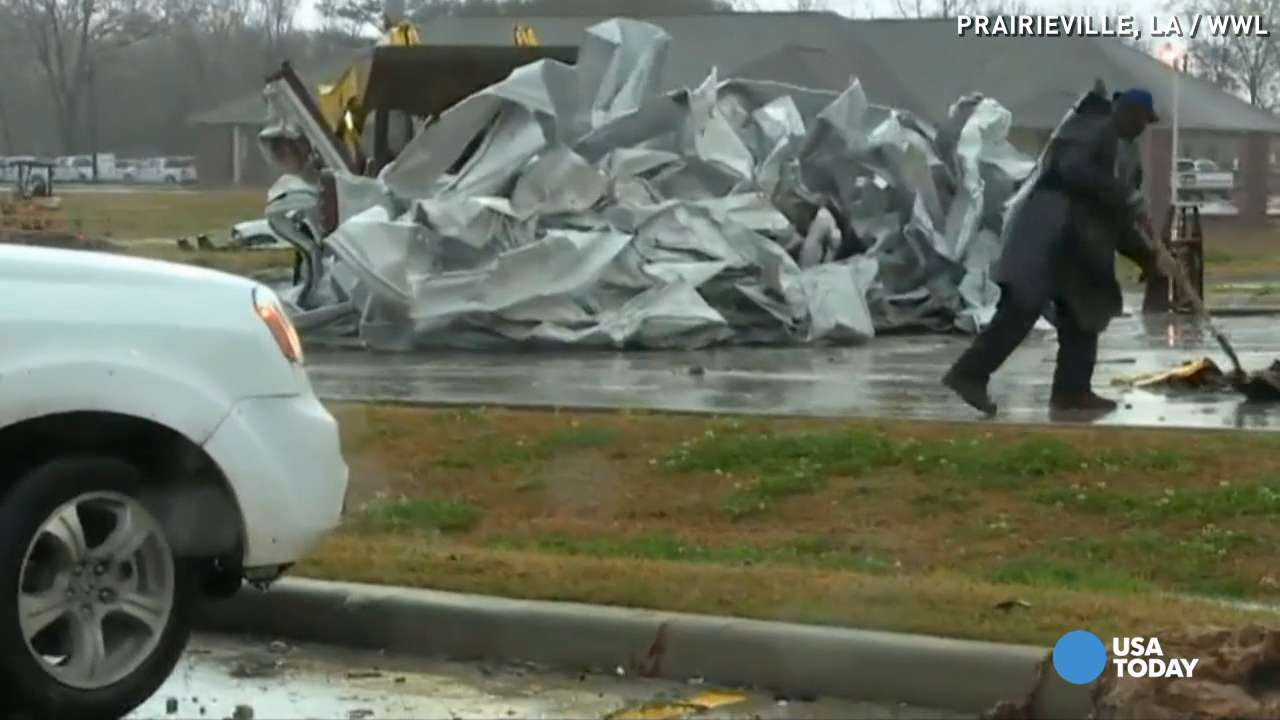 Suspected tornado tears off roof, wall of gym