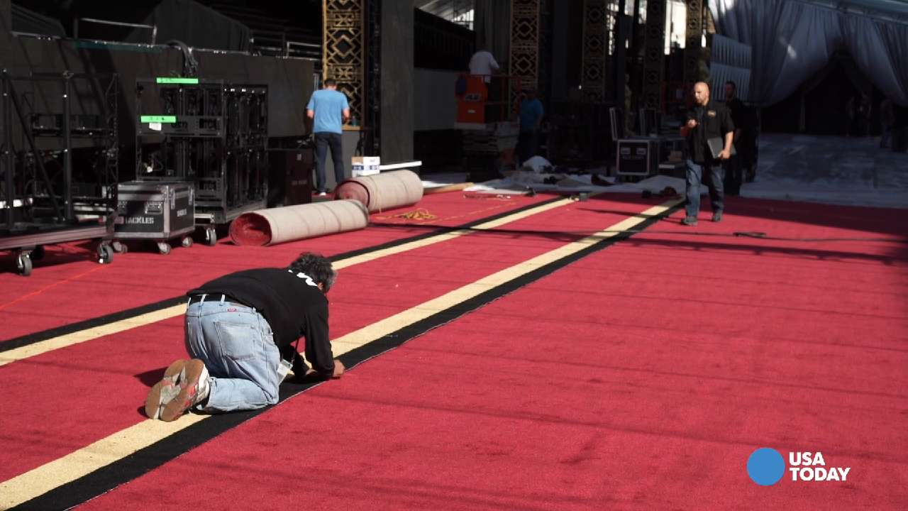Watch what goes into laying down the Oscars red carpet