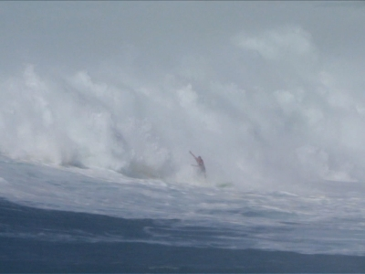 Surfer rides 60-foot waves to $75k win