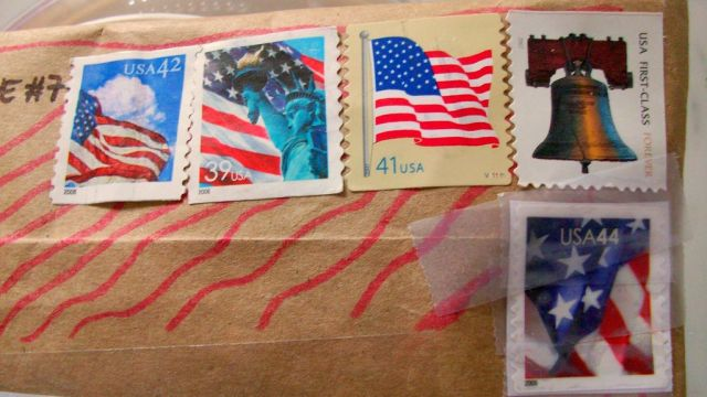Postage prices drop for first time in 100 years