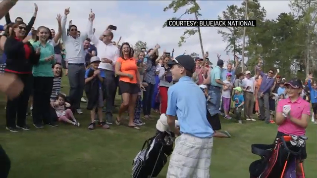 An 11-year-old boy played the opening shot on a new golf course with co-designer Tiger Woods watching — and scored a hole-in-one. (March 3)