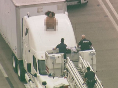 Naked, dancing woman on top of big rig shuts down highway