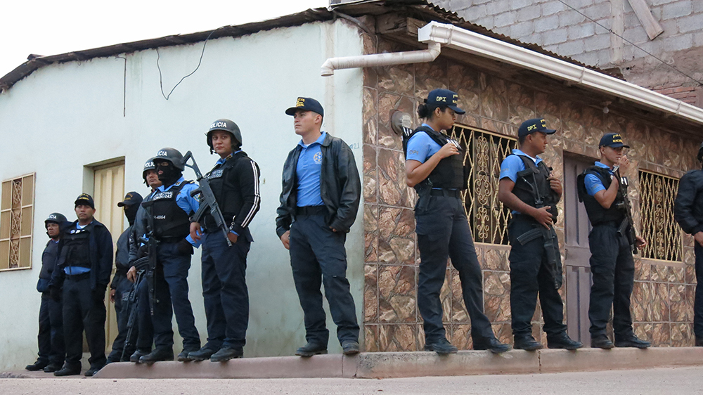 Members of a specialized, U.S.-trained unit of the Honduran National Police, called Los Tigres, conduct a sweep of the violent San Miguel neighborhood in Tegucigalpa, Honduras, on Feb. 9, 2016.