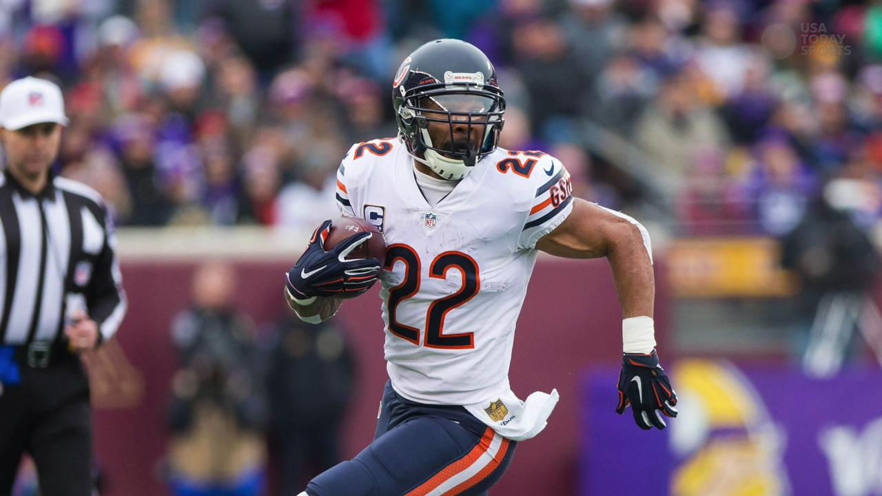 Chicago Bears running back Matt Forte (22) runs off the field after the NFL game against the Detroit Lions at Soldier Field.