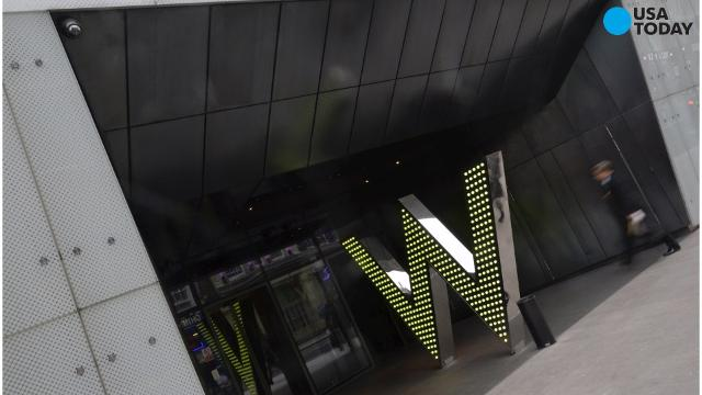 FILE  - In this Wednesday, July 31, 2013, file photo, a W Hotel is located in Times Square, in New York.  The luxury hotel is owned by Starwood Hotels & Resorts Worldwide, who reports earnings on Thursday, Feb. 13, 2014. (AP Photo/Mark Lennihan) ORG XMIT: NYBZ137
