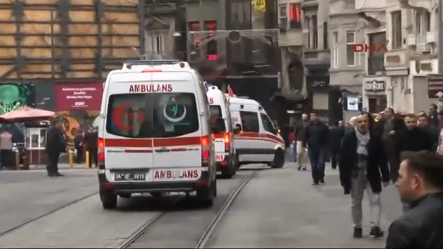 Emergency services carry an injured victim from the scene of a street explosion in Istanbul, Turkey, March 19, 2016.