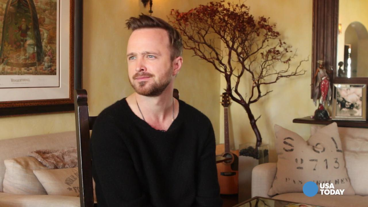 Aaron Paul as Eddie Lane, a convert to Meyerism suffering a crisis of faith.
