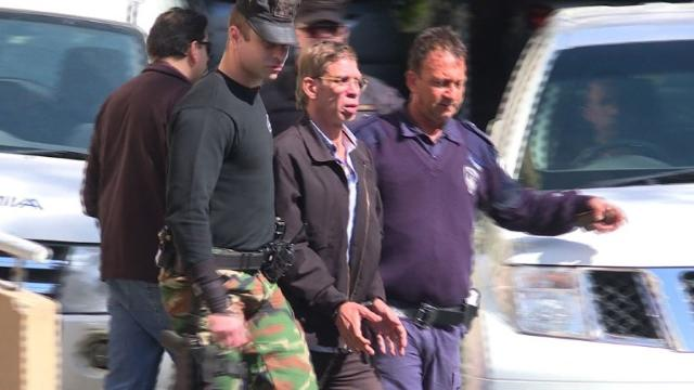 The man accused of hijacking an EgyptAir plane and forcing it to land in Cyprus was remanded into police custody for eight days during his first court appearance on Wednesday. Video provided by AFP