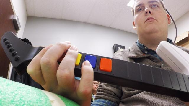 Scientists help a paralyzed man play 'Guitar Hero'