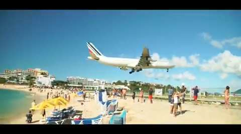 Planes land close to the beach at Maho Beach in St.