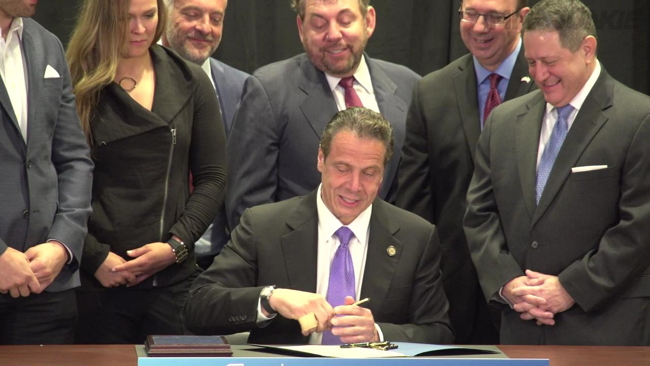 Ronda Rousey, Chris Weidman and UFC CEO Lorenzo Fertitta made speeches and comments to press at a public bill signing that made mixed martial arts legal in NY, the last US state to do so