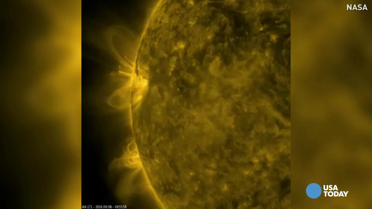 NASA captured a highly concentrated magnetized region of the sun, in which charged particles emit beautiful arches of ultraviolet light into space.
