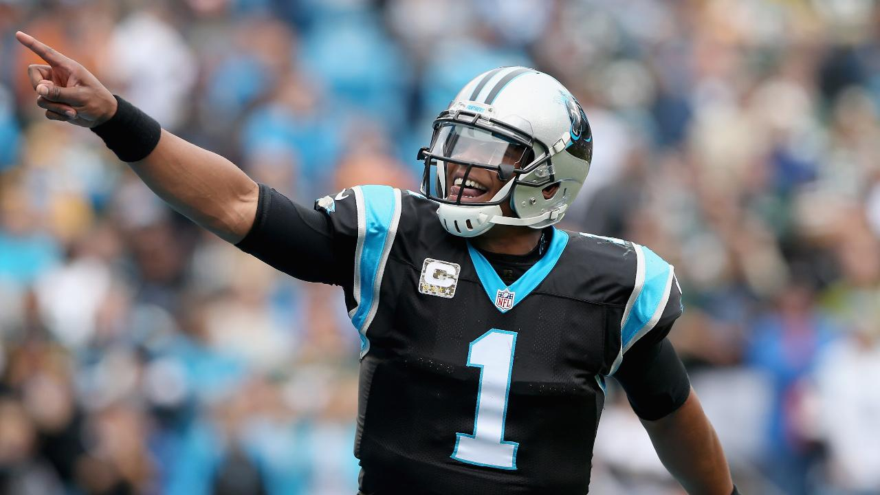 Watch Cam Newton hops fence to play football with seventh-graders