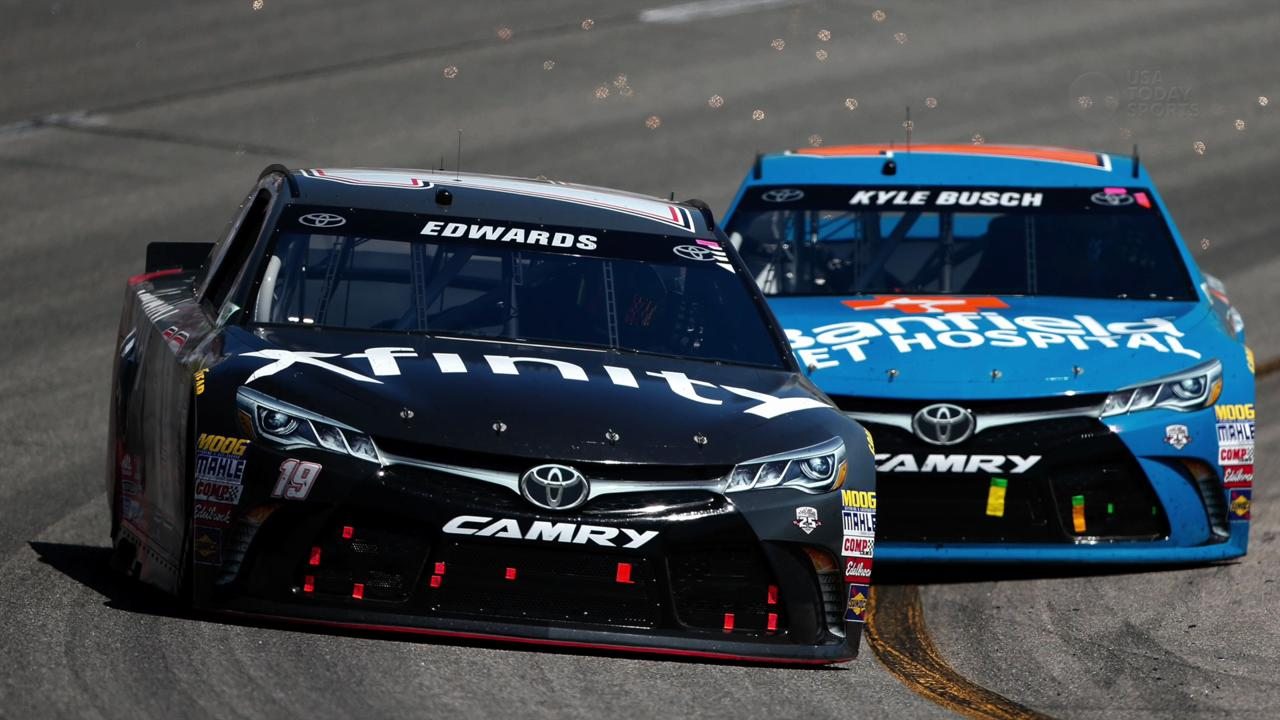Edwards bumped teammate Kyle Busch down the stretch and won the race Sunday.