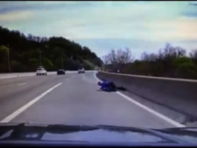 Cop tackles man trying to jump off bridge