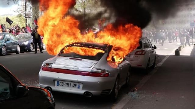 Police hurt, scores arrested as French protests turn violent