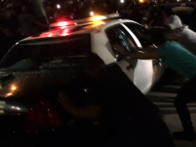 Raw: Protesters Attack Cop Car After Trump Rally