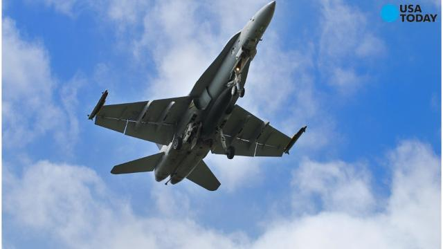 A Russian fighter plane that flew near a U.S. spy plane last week performed a barrel roll during the maneuver, according to Pentagon officials.