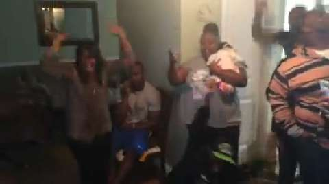 San Jose State running back Tyler Ervin celebrates at home with family after getting call from the Houston Texans that they were drafting him in the fourth round.