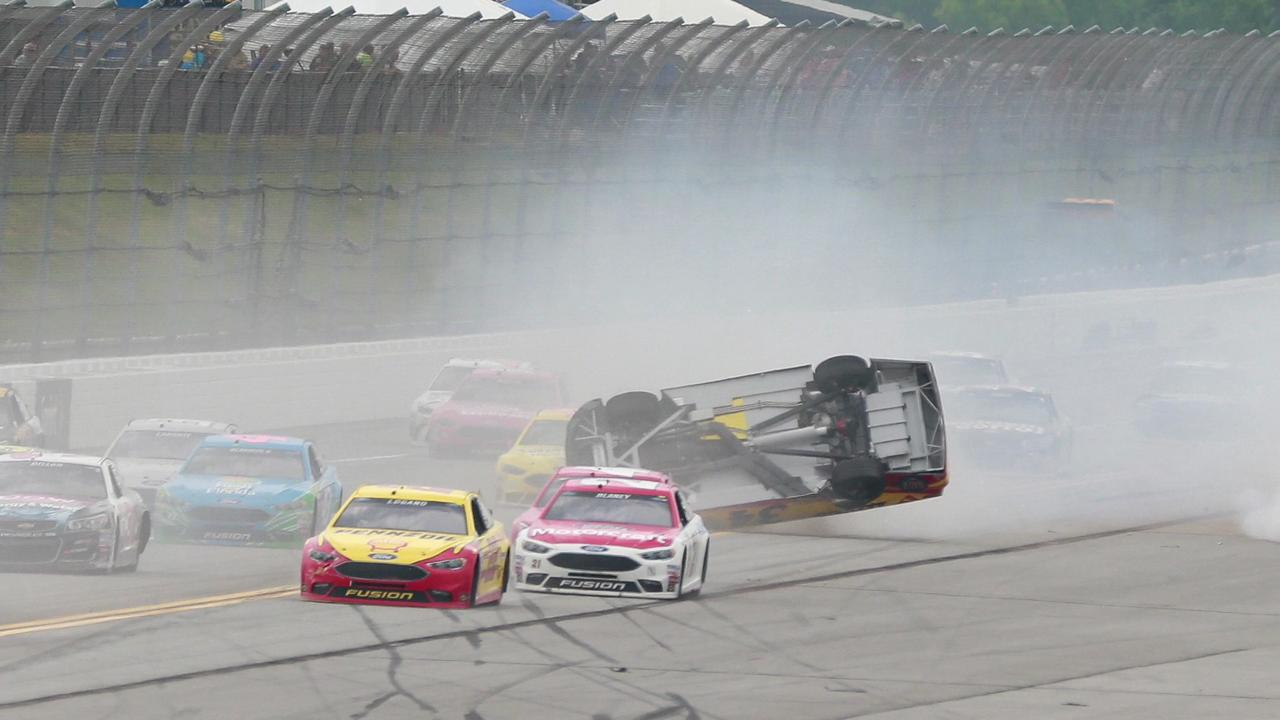 Matt Kenseth (20) spins as Joey Logano (22) races by