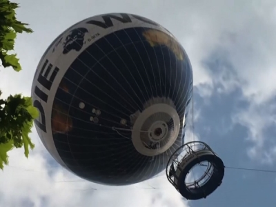 Several people were treated for shock after a helium passenger balloon in Berlin was shaken around wildly by gusty winds for several minutes on Tuesday afternoon. (May 3)