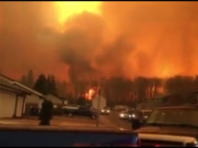 New cell phone video shows raging wildfire that emptied Canada's main oil sands city. The fire destroyed entire neighborhoods of Fort McMurray, Alberta, where officials warned Wednesday that all efforts to suppress the fire have failed. (May 4)