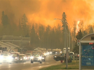 Alberta declared a state of emergency Wednesday as crews frantically held back wind-whipped wildfires that had already torched 1,600 homes and other buildings in Canada's main oil sands city of Fort McMurray, forcing over 80,000 residents to flee. (
