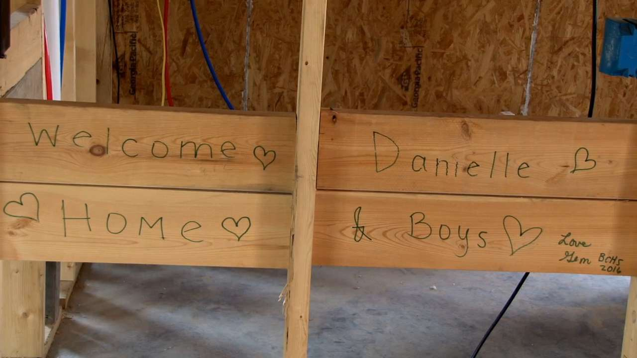 Danielle and several volunteers are building her new home through a campaign with Habitat for Humanity. The home will provide a safe space for her disabled sons, who are looking forward to the independence they'll have in a universal designed home.