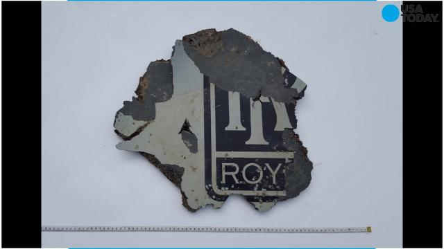 Australian investigators identified a piece of wreckage found on a remote Indian Ocean island as part of closet door in the forward cabin of the Boeing 777 that went missing on March 8, 2014.