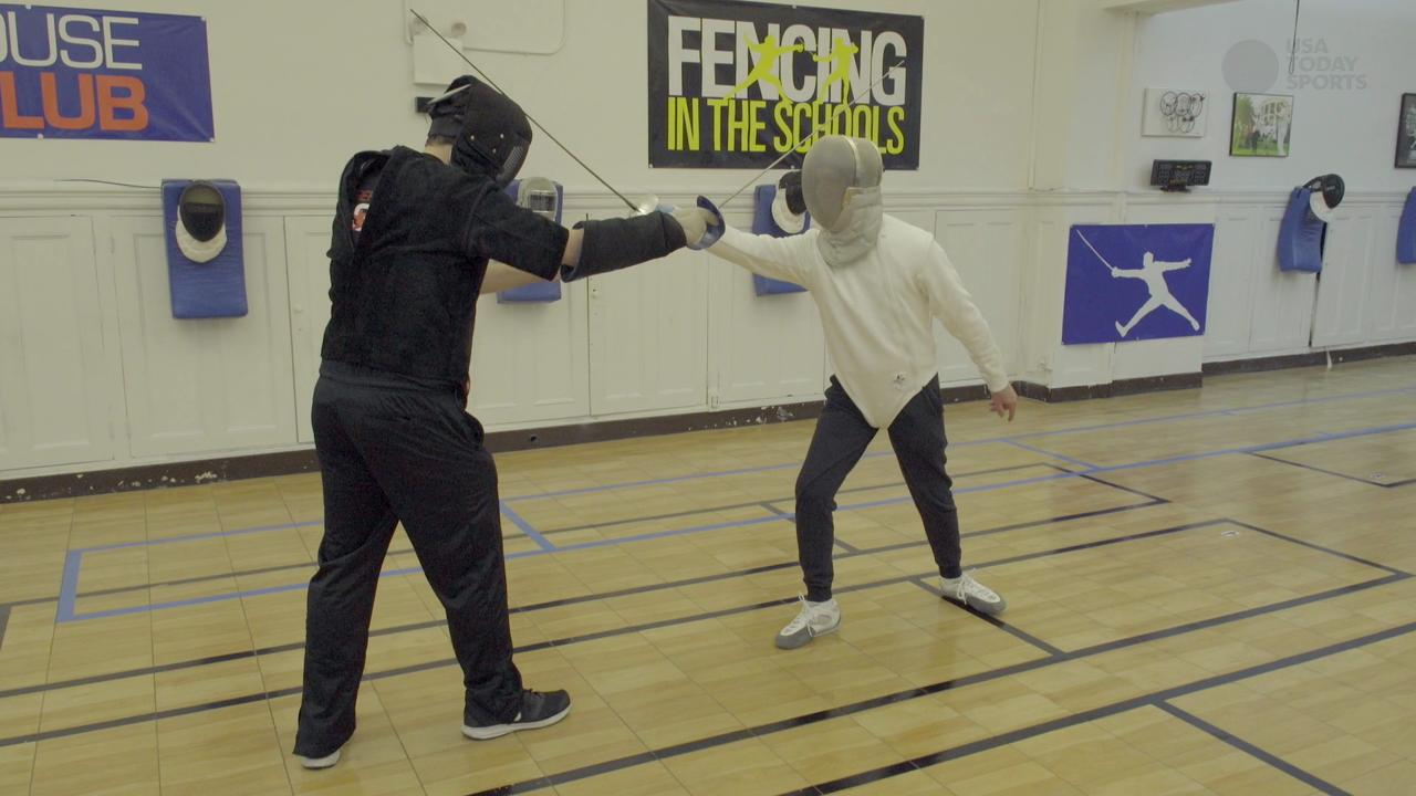 'Project Runway' mentor Tim Gunn has taken on fencing with U.S. Olympic fencer Tim Morehouse.