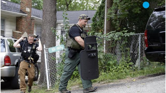 Police in Manchester said that two New Hampshire police officers were shot Friday and a manhunt is underway for an armed suspect.