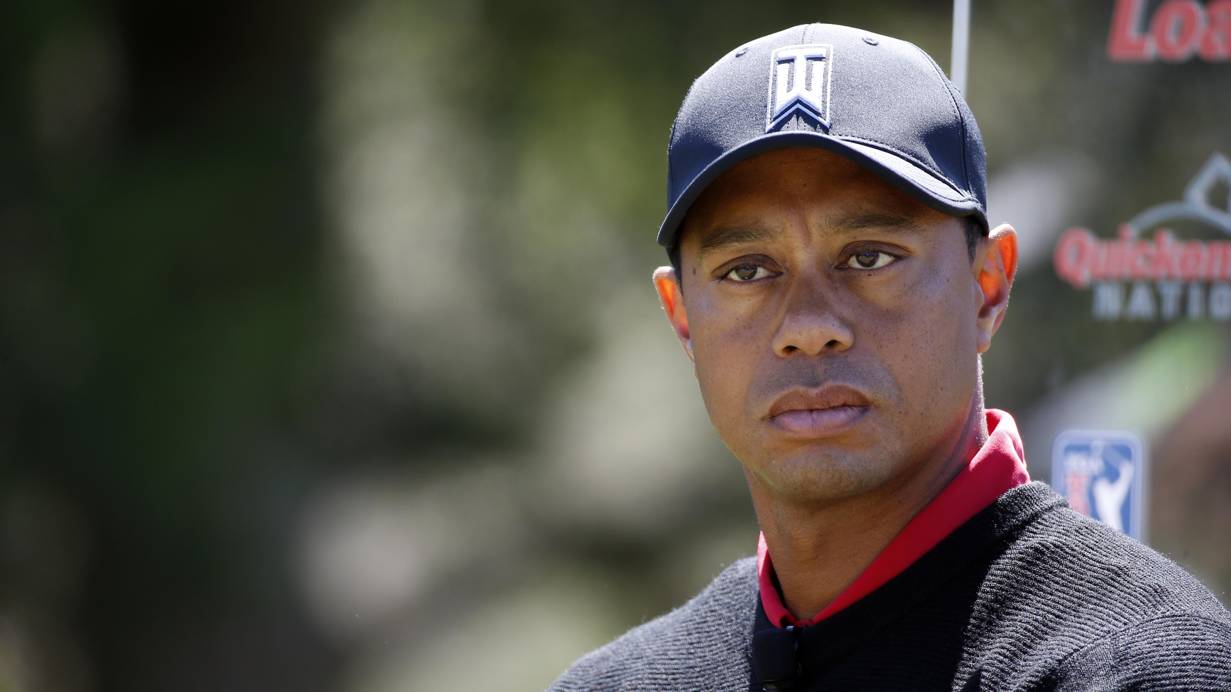 Tiger Woods puts three in the drink