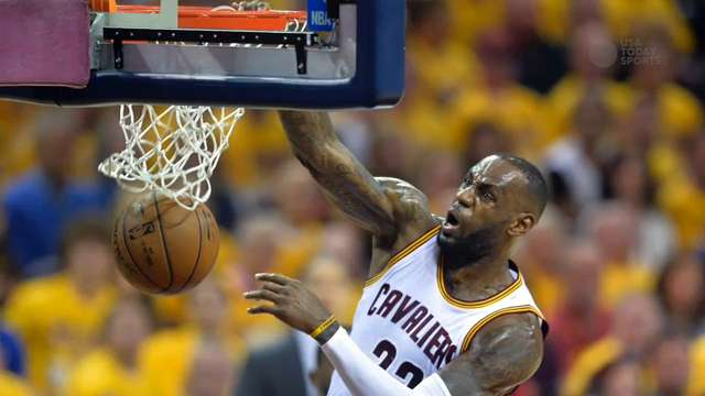 LeBron James reacts beside Toronto Raptors forward Patrick Patterson after dunking in the second quarter of Game 1.