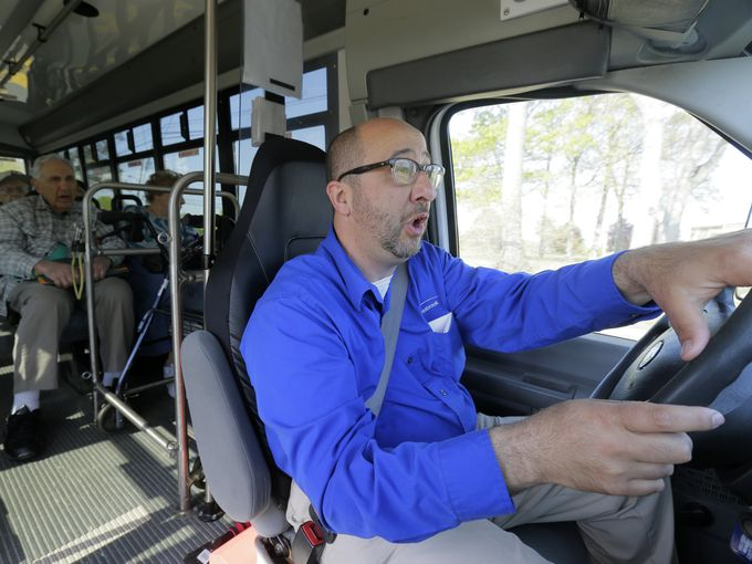 Opera-trained bus driver belts out tunes