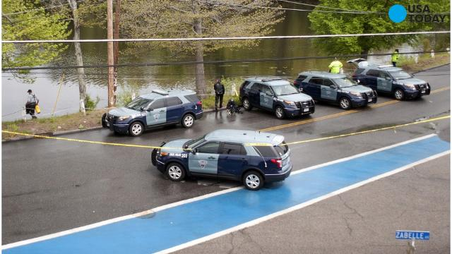 On Sunday, authorities say a manhunt was underway for a suspect who shot and killed a police officer during a traffic stop in central Massachusetts. Chief Andrew Sluckis said during a news conference that Auburn police Officer Ronald Tarentino was s