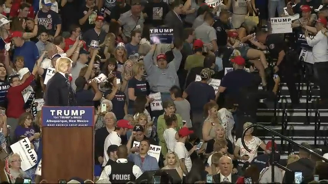 Republican presidential hopeful Donald Trump rallied thousands of supporters during a stop in Albuquerque on Tuesday night as protesters tried to derail his speech. (May 24)
