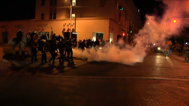 Protests outside a Donald Trump campaign rally in Albuquerque, New Mexico turned violent on Tuesday night. Demonstrators threw burning T-shirts and other objects at police as their focus shifted from Trump to the Albuquerque Police Department. (May