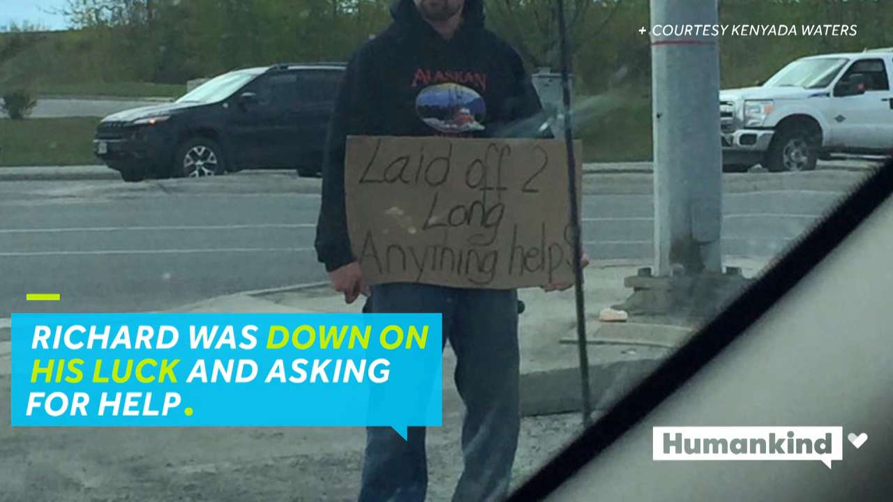 Man with cardboard sign gets gift from stranger
