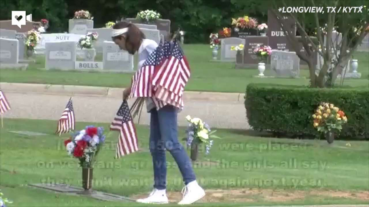 Girl Scouts place American flags on veterans' graves