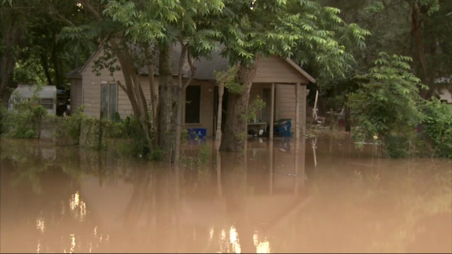 The Brazos River is expected to crest at a record level of 53.5 feet in Fort Bend County, southeast Texas on Tuesday. Large areas of the county are already under water. (May 31)