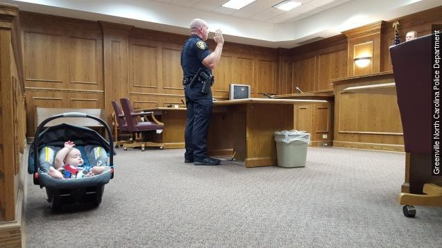 Officer Phillip Haning was getting sworn in with the Greenville Police Department in North Carolina when his infant son decided to join in.Video provided by Newsy