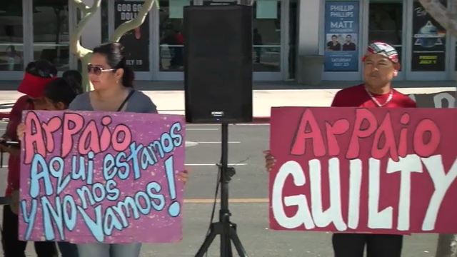 Several dozen protesters gathered outside the federal courthouse in Phoenix on Tuesday as an Arizona sheriff faced a judge over accusations that he violated court orders in a racial profiling case. (May 31)