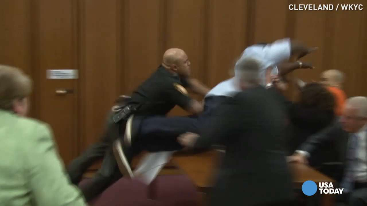 Father lunges at his daughter's killer in court