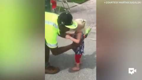 Toddler triplets and garbage men are BFFs