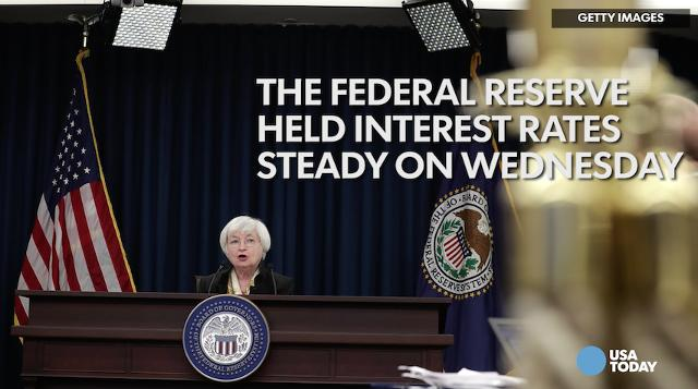 The Federal Reserve held interest rates steady on Wednesday and predicted more gradual hikes the next few years amid somewhat slower economic growth.