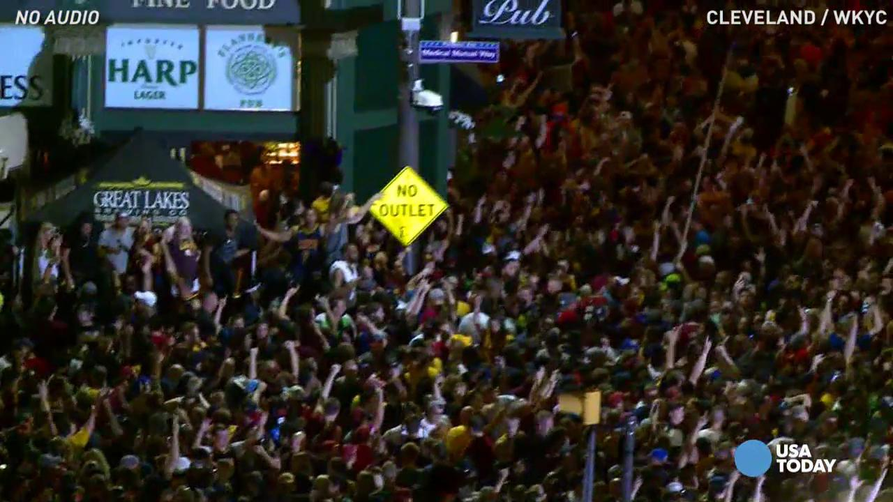 Cavs fans flooded the streets after the game, ending Cleveland's 52-year title drought.