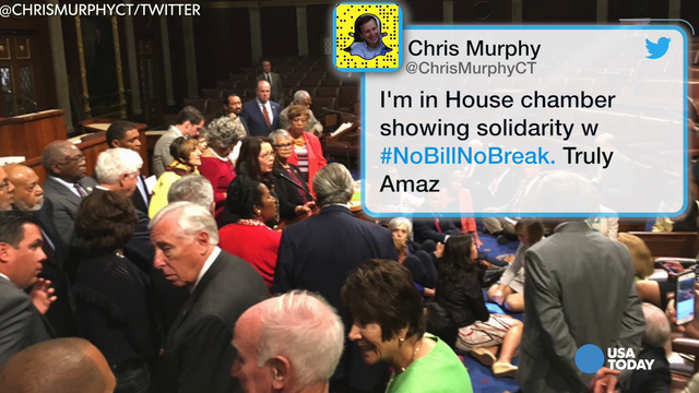 Sen. Chris Murphy, D-Conn., heads to the House chamber on Capitol Hill in Washington Wednesday to show support for the sit-down protest, seeking a vote on gun control measures on the floor of the House.